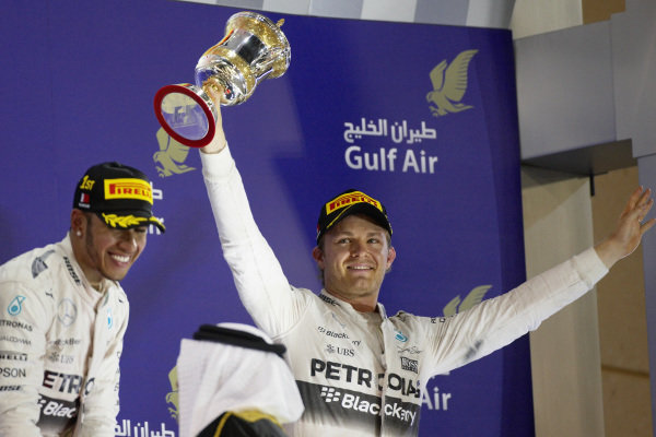 Nico Rosberg, 3rd position celebrates with his trophy and Lewis Hamilton, 1st position.