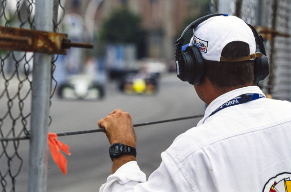 A marshal watches the track action.