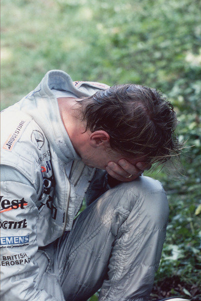 Mika Häkkinen is distraught after crashing out of the lead of the race.