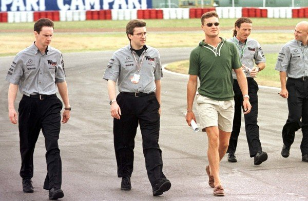1998 Argentinian Grand Prix.Buenos Aires, Argentina.10-12 April 1998.David Coulthard (McLaren Mercedes-Benz) walks the track with his mechanics and team members.World Copyright - LAT Photographic