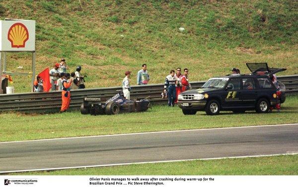 1998 Brazilian Grand Prix.Interlagos, Sao Paulo, Brazil.27-29 March 1998.Olivier Panis (Prost AP01 Peugeot) walks away after crashing during the warm-up.World Copyright - Steve Etherington/LAT Photographic