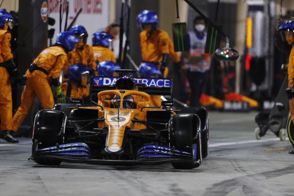 Carlos Sainz, McLaren MCL35, leaves his pit box