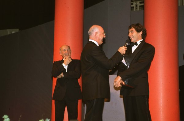 1991 Autosport Awards, Grosvenor House Hotel, Park Lane, London, Great Britain.Ayrton Senna receives International Racing Driver of the Year from Murray Walker.Ref-S1A 03.World - LAT Photographic
