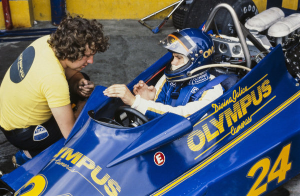 Divina Galica sits in her Hesketh 308E Ford. Charlie Whiting sits beside the car.