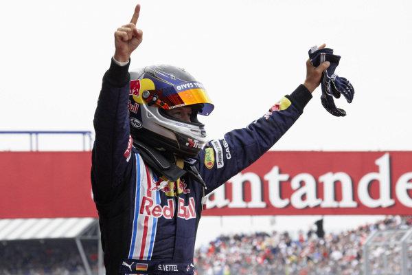 Sebastian Vettel celebrates victory in parc ferme.