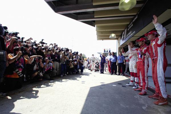 The top 3 qualifiers: Jarno Trulli, pole sitter Felipe Massa and Kimi Räikkönen.