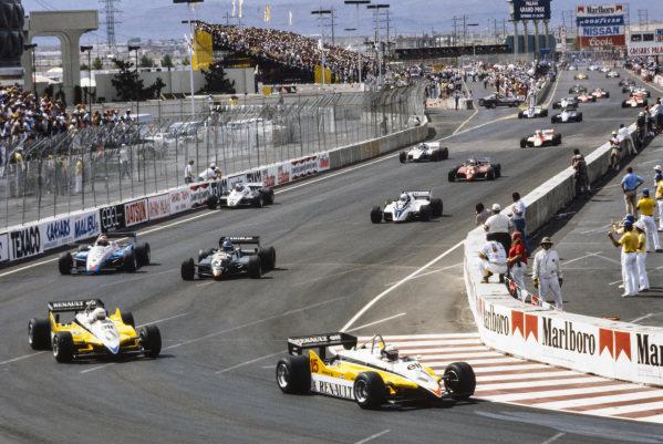 Alain Prost, Renault RE30B, leads René Arnoux, Renault RE30B, Michele Alboreto, Tyrrell 011 Ford, Eddie Cheever, Ligier JS19 Matra, Riccardo Patrese, Brabham BT50 BMW, and Keke Rosberg, Williams FW08 Ford, at the start.