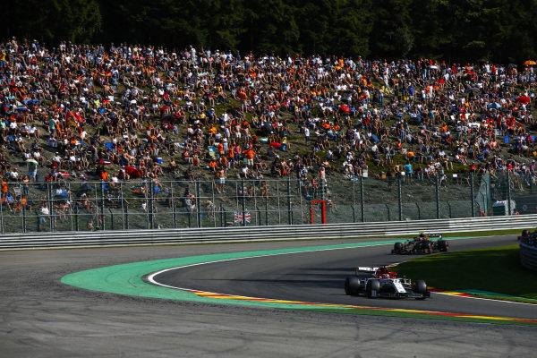 Kimi Raikkonen, Alfa Romeo Racing C38, leads Kevin Magnussen, Haas VF-19