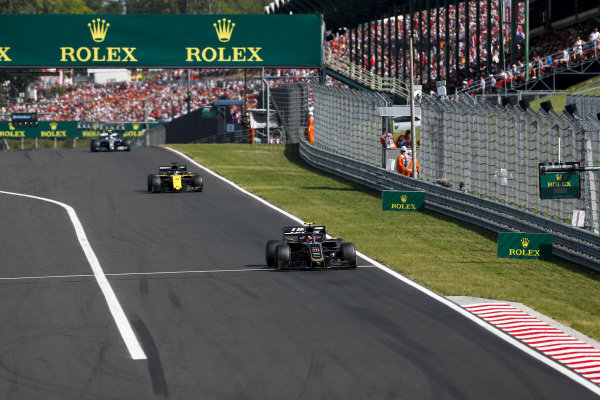 Kevin Magnussen, Haas VF-19, leads Daniel Ricciardo, Renault R.S.19, and Valtteri Bottas, Mercedes AMG W10