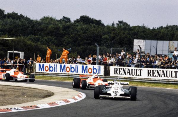 Carlos Reutemann, Williams FW07C Ford, leads Mario Andretti, Alfa Romeo 179C, and Bruno Giacomelli, Alfa Romeo 179C.