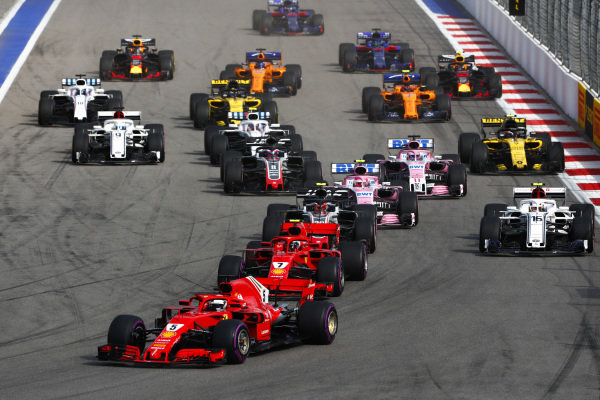 Sebastian Vettel, Ferrari SF71H, leads Kimi Raikkonen, Ferrari SF71H, and Kevin Magnussen, Haas F1 Team VF-18
