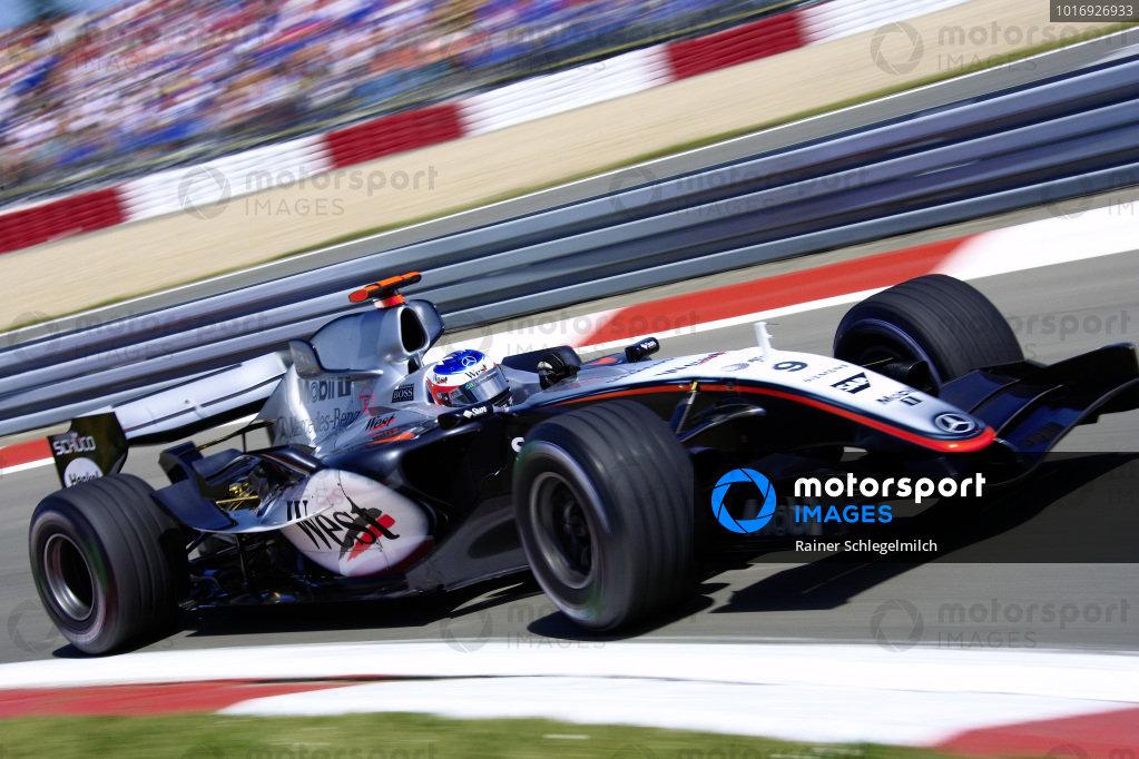 Kimi Raikkonen, McLaren Mercedes MP4-20, at pitlane entry.