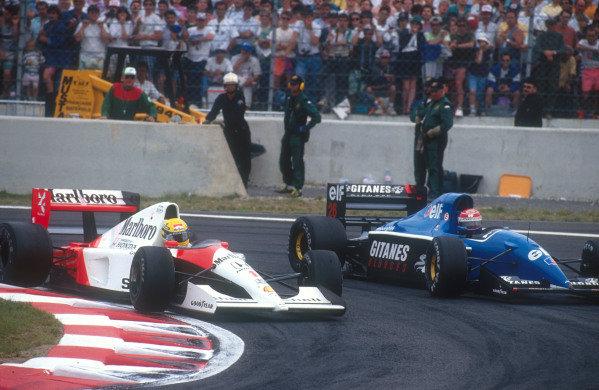 1991 French Grand Prix.Magny-Cours, France.5-7 July 1991.Ayrton Senna (McLaren MP4/6 Honda) passes down the inside of backmarker Erik Comas (Ligier JS35 Lamborghini).Ref-91 FRA 08.World Copyright - LAT Photographic