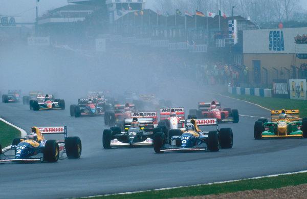 1993 European Grand Prix. Donington Park, England. 9-11 April 1993. Alain Prost leads teammate Damon Hill (both Williams FW15C Renault's), Karl Wendlinger (Sauber C12 Ilmor), Ayrton Senna (McLaren MP4/8 Ford), Michael Schumacher (Benetton B193B Ford) and Michael Andretti (McLaren MP4/8 Ford) into Redgate Corner at the start.  Ref-93 EUR 07. World Copyright - LAT Photographic