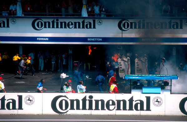 1994 German Grand Prix.Hockenheim, Germany.29-31 July 1994.Jos Verstappen (Benetton B194 Ford) came in for his pitstop. As the Refueller pulled the fuel hose away the valve stuck open allowing fuel to still come out of the nozzle and over the car which ignited into a huge fireball. The fire was delt with quite swiftly though.Ref-94 GER 50.World Copyright - LAT Photographic