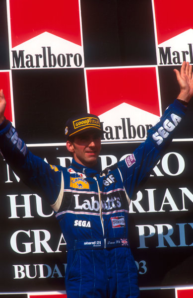 1993 Hungarian Grand Prix.Hungaroring, Budapest, Hungary.13-15 August 1993.Damon Hill (Williams Renault) celebrates his maiden Grand Prix win on the podium.Ref-93 HUN 03.World Copyright - LAT Photographic