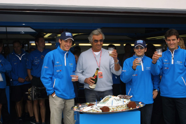 2001 San Marino Grand Prix.Imola, Italy. 13-15 April 2001.Jenson Button, Giancarlo Fisichella and Mark Webber (all Benetton Renault) help Flavio Briatore celebrate his birthday.World Copyright - LAT Photographicref: 8 9 MB Digital