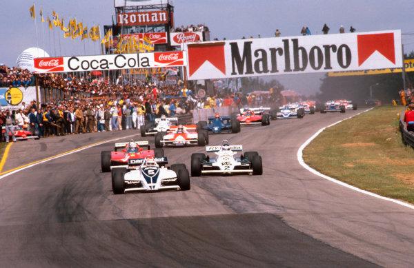 1981 Belgian Grand Prix.Zolder, Belgium.15-17 May 1981.Nelson Piquet (Brabham BT49C Ford) leads Carlos Reutemann (Williams FW07C Ford) and Didier Pironi (Ferrari 126CK) at the start. Ref-81 BEL 05.World Copyright - LAT Photographic