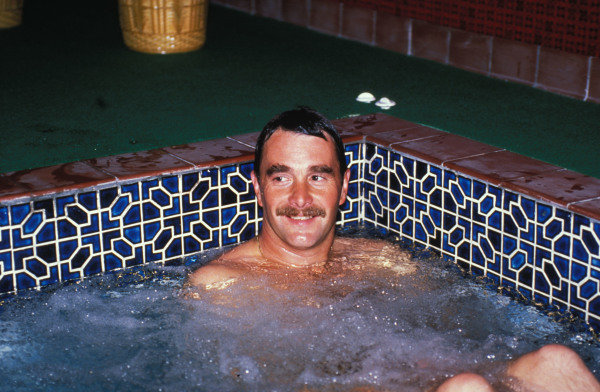 Isle of Man, United Kingdon. 18/4/1989. Nigel Mansell relaxes at home in the bath