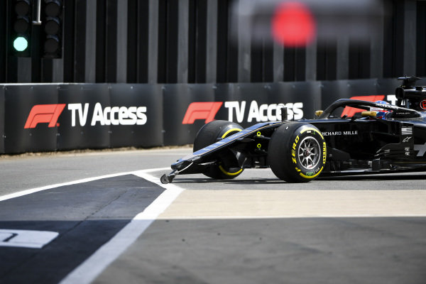 Romain Grosjean, Haas VF-19 crashes at the end of the pit lane