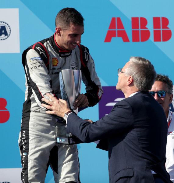 Sébastien Buemi (CHE), Nissan e.Dams, 3rd position, receives his trophy on the podium