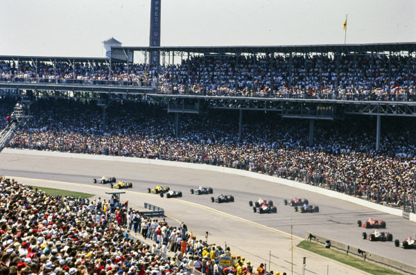 The field heads through turn one.