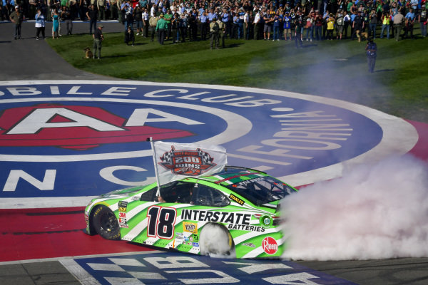 #18: Kyle Busch, Joe Gibbs Racing, Toyota Camry Interstate Batteries celebrates with a burnout after winning