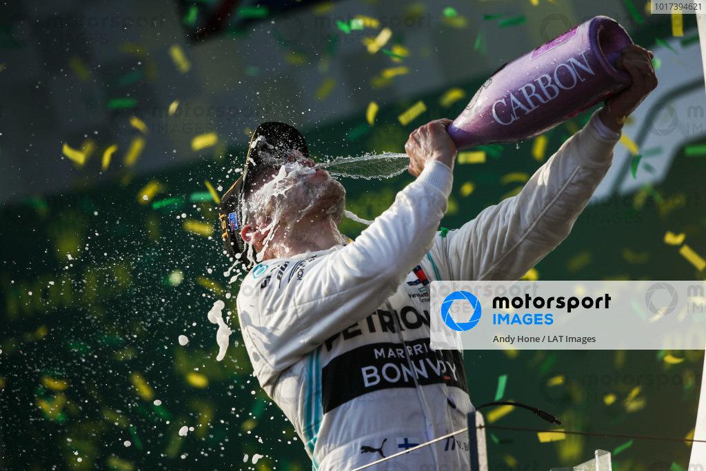 Valtteri Bottas, Mercedes AMG F1, 1st position, blasts himself with Champagne on the podium
