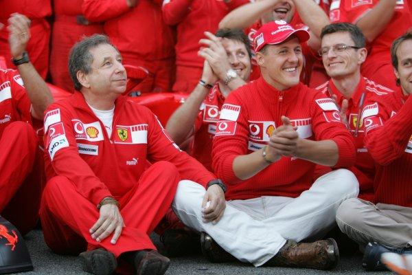 2006 Brazilian Grand Prix - Sunday Race Interlagos, Sao Paulo, Brazil. 19th - 22nd October 2006. The Ferrari team say goodbye to Michael Schumacher after the 7 times World Champion retires, portrait. World Copyright: Lorenzo Bellanca/LAT Photographic ref: Digital Image MU4Z4378