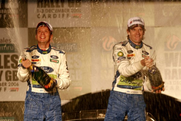 2006 World Rally Championship.Round 16, Wales Rally GB. 1st - 3rd  December 2006.Marcus Gronholm/Timo Rautianen Ford Focus RS WRC 06 celebrate victory on the podium/finish ramp.Portrait.World Copyright: Drew Gibson/LAT Photographic.Ref: Digital Image Only.