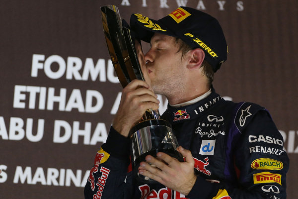 Race winner Sebastian Vettel (GER) Red Bull Racing celebrates on the podium. Formula One World Championship, Rd17, Abu Dhabi Grand Prix, Race Day, Yas Marina Circuit, Abu Dhabi, UAE, Sunday 3 November 2013. BEST IMAGE