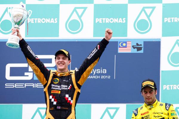 Sepang, Kuala Lumpur, Malaysia. 25th March 2012. Sunday Race.James Calado (GBR, Lotus GP) celebrates his victory on the podium. World Copyright: Alastair Staley/GP2 Series Media Service.Ref: Digital Image AS5D7677.jpg