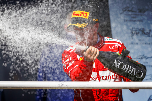 Interlagos, Sao Paulo, Brazil. Sunday 12 November 2017. Winner Sebastian Vettel, Ferrari, 1st Position, sprays the champagne on the podium. World Copyright: Andy Hone/LAT Images  ref: Digital Image _ONZ6951