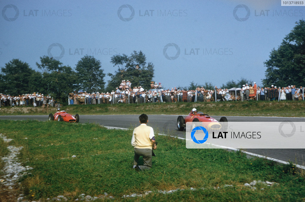 Monza, Italy. 6-8 September 1957. Wolfgang von Trips (Lancia-Ferrari D50 801) leads Giorgio Scarlatti (Maserati 250F). They finished in 3rd and 5th positions respectively. Ref: 57ITA20. World Copyright - LAT Photographic