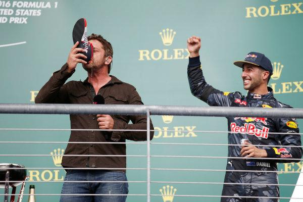Circuit of the Americas, Austin Texas, USA. Sunday 23 October 2016. Gerard Butler drinks from the shoe of Daniel Ricciardo, Red Bull Racing, 3rd Position, on the podium. World Copyright: Sam Bloxham/LAT Photographic ref: Digital Image _SLA2694