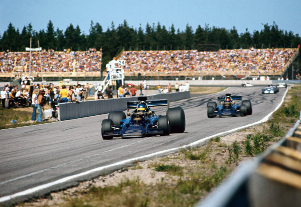 1973 Swedish Grand Prix.  Anderstorp, Sweden. 17 June 1973.  Ronnie Peterson, (Lotus 72D-Ford), 2nd position, leads Emerson Fittipaldi (Lotus 72D-Ford), retired.  Ref: 73SWE84. World Copyright: LAT Photographic.