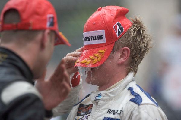 2005 GP2 Series - MonacoMonte-Carlo. 20th & 21st MaySaturday - RaceAdam Carroll (GB, Super Nova International). gets it in the face with the ChampangePhoto: GP2 Series Media Serviceref: Digital Image Only.