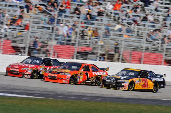 5-7 March 2010, Hampton, Georgia, USAJeff Burton, Jamie McMurray and Tony Stewart race 3 wide©2010, LAT South, USALAT Photographic