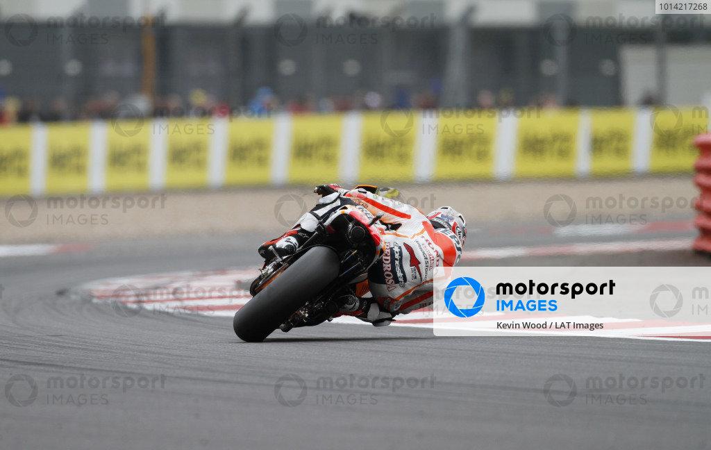 2014 MotoGP Championship  British Grand Prix.  Silverstone, England. 29th - 30st August 2014.  Dani Pedrosa, Honda, drifts through Woodcote corner.  Ref: _W7_8409. World copyright: Kevin Wood/LAT Photographic