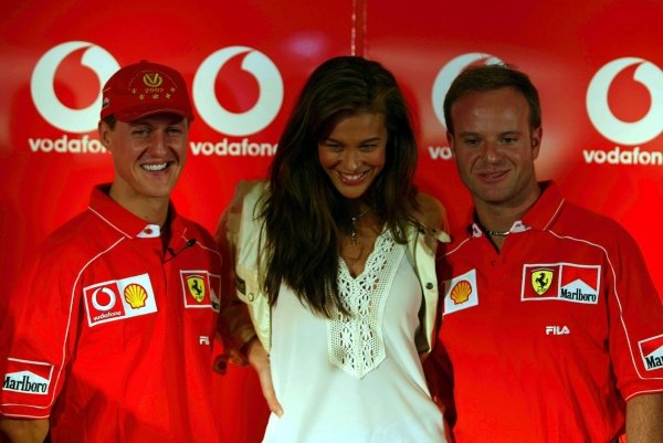 Michael Schumacher (GER) and Rubens Barrichello (BRA) get to grips with the latest Vodafone model at a Ferrari Vodafone press conference.
