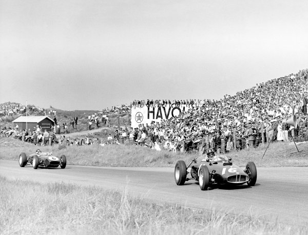 1960 Dutch Grand Prix. Zandvoort, Holland. 6 June 1960. Graham Hill (BRM P48) leads Jim Clark (Lotus 18-Climax) on the latter's debut. World Copyright: LAT Photographic Ref: Autocar Glass Plate C58405.
