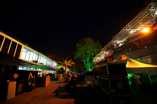 Sepang International Circuit, Sepang, Kuala Lumpur, Malaysia. Sunday 30 March 2014. Night falls on the busy paddock as the circus packs away to head to the next round. World Copyright: Charles Coates/LAT Photographic. ref: Digital Image _N7T8924