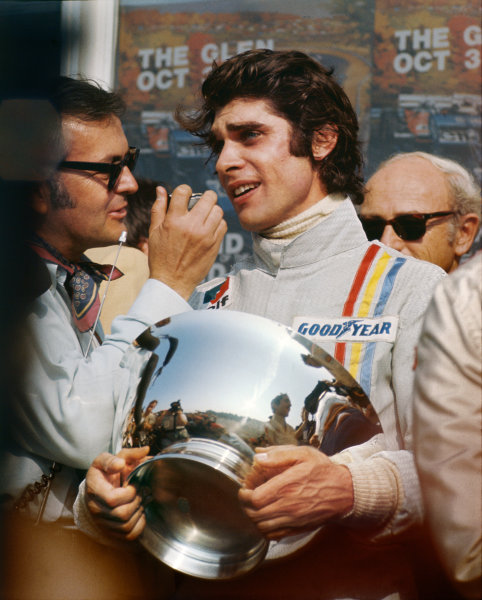 1971 United States Grand Prix.  Watkins Glen, New York, USA. 1st-3rd October 1971.  François Cevert, Tyrrell, 1st position, is interviewed on the podium.  Ref: 71USA66. World Copyright: LAT Photographic