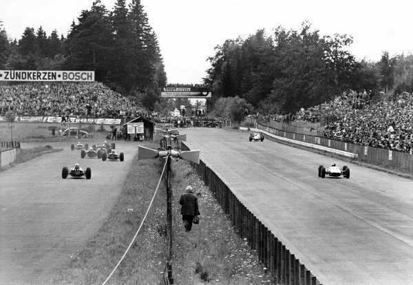 1965 German Grand Prix.  Nurgburgring, Germany. 1st August 1965. Jim Clark (Lotus 33 - Climax), 1st position, leads the rest of the field out of south curve on his way to victory, action.  World Copyright: LAT Photographic.