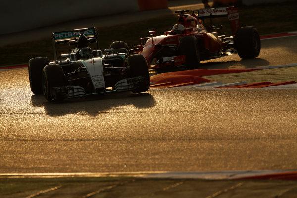 2015 F1 Pre Season Test 3 - Day 4 Circuit de Catalunya, Barcelona, Spain. Thursday  Sunday 1 March 2015. Nico Rosberg, Mercedes F1 W06 Hybrid & Sebastian Vettel, Ferrari SF15-T.  World Copyright: Sam Bloxham/LAT Photographic. ref: Digital Image _14P5457