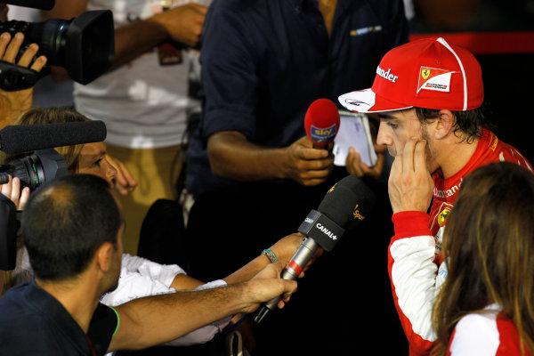 Marina Bay Circuit, Singapore. Saturday 21st September 2013.  Fernando Alonso, Ferrari F138, talks to the media.  World Copyright: Jed Leicester/LAT Photographic. ref: Digital Image _JEL2765