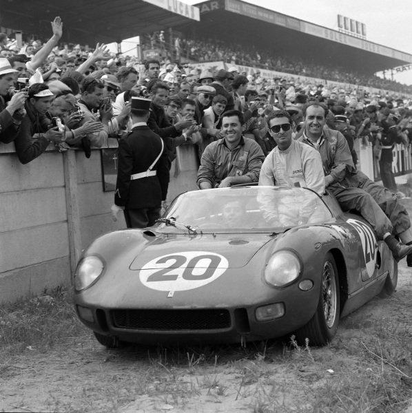 Jean Guichet / Nino Vaccarella, Scuderia Ferrari, Ferrari 275P, with mechanics, drive past the crowd on their way to parc ferme and the podium.