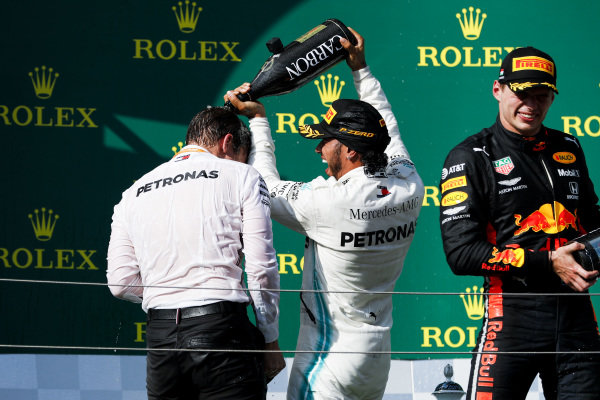 James Vowles, Motorsport Strategy Director, Mercedes AMG F1 and Race winner Lewis Hamilton, Mercedes AMG F1 celebrate on the podium with the champagne and Max Verstappen, Red Bull Racing