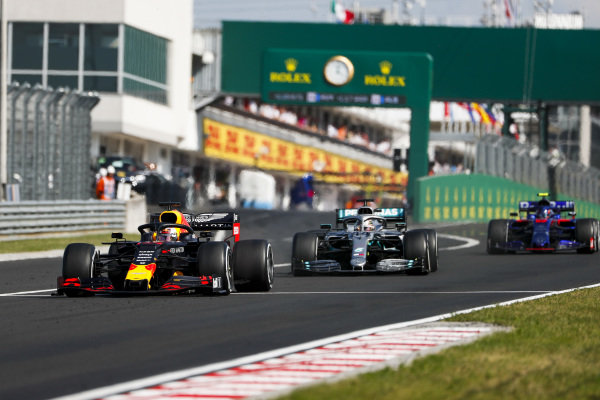 Max Verstappen, Red Bull Racing RB15, leads Lewis Hamilton, Mercedes AMG F1 W10, and Alexander Albon, Toro Rosso STR14