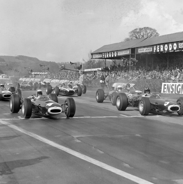 Graham Hill, BRM P261 leads Jackie Stewart, BRM P261 at the start.
